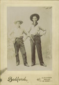 Photography:Official Photos, TWO TEXAS COWBOYS WITH COLT REVOLVERS & BOWIES 1880s. Dallas,Texas. Very nice studio shot of two young cowboys. They both ...(Total: 1 Item)