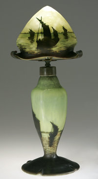 A French Glass Lamp Daum Nancy, Late Nineteenth Century  The glass body and shade in brown to yellow/green depicting boa...