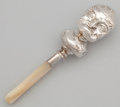 Silver Smalls:Other , A VICTORIAN SILVER AND MOTHER-OF-PEARL BABY RATTLE . Unidentifiedmaker, Birmingham, England, 1886-1887. Marks: (lion passan...