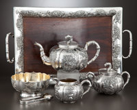 A FIVE-PIECE CHINESE EXPORT SILVER, SILVER GILT AND ROSEWOOD TEA SERVICE WITH TRAY Wang Hing & Co., Hong Kong and