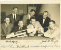 "Autographs:Celebrities, Project Mercury Signed B&W Photograph, 10"" x 8"". Taken July 12,1962, the original Mercury astronauts are pictured around a ...(Total: 1 Item)"