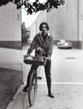 Photographs:20th Century, SID AVERY (American, 1918-2002). Audrey Hepburn on her Bike atParamount Studios, Press Print, 1957. Vintage gelatin...