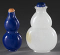 Asian:Chinese, CHINESE CARVED GLASS SNUFF BOTTLES. Pair of Chinese carved glassdouble gourd form snuff bottles. One of white coloration ...(Total: 2 )