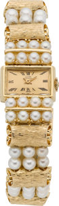 Timepieces:Wristwatch, Lucien Piccard Lady's Pearl & Gold Wristwatch, circa 1970's....