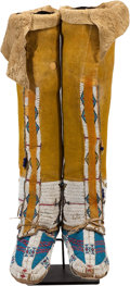 Paintings, A PAIR OF CHEYENNE BEADED HIDE BOOT MOCCASINS . c. 1890... (Total: 2 Items)
