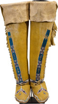 American Indian Art:Beadwork and Quillwork, A PAIR OF KIOWA BEADED HIDE BOOT MOCCASINS. c. 1890... (Total: 2Items)