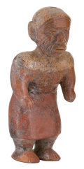 Antiques:Antiquities, Aged Female Figure Wearing a Wrap Skirt...