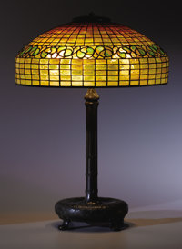 "TIFFANY STUDIOS A ""Lemon Leaf"" leaded glass and bronze table lamp, circa 1910 Shade and base stamped 25-3/4..."