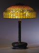"TIFFANY STUDIOS A ""Lemon Leaf"" leaded glass and bronze table lamp, circa 1910 Shade and base stamped 25-3/4 in..."