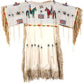 American Indian Art:Beadwork and Quillwork, A SIOUX GIRL'S PICTORIAL BEADED AND FRINGED HIDE DRESS. c. 1910...