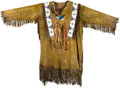 American Indian Art:Beadwork and Quillwork, A PLAINS BEADED AND FRINGED HIDE TUNIC. c. 1900...