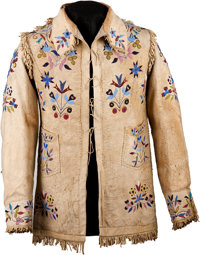 A SANTEE SIOUX PICTORIAL BEADED AND FRINGED HIDE JACKET c. 1890