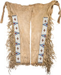 American Indian Art:Beadwork and Quillwork, A PAIR OF SIOUX BEADED AND FRINGED HIDE LEGGINGS. c. 1890...(Total: 2 Items)