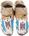 American Indian Art:Beadwork and Quillwork, A PAIR OF CHEYENNE/ARAPAHO BEADED HIDE MOCCASINS. c. 1900...(Total: 2 Items)