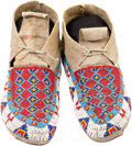 American Indian Art:Beadwork and Quillwork, A PAIR OF SIOUX BEADED HIDE MOCCASINS. c. 1930... (Total: 2 Items)