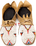 American Indian Art:Beadwork and Quillwork, A PAIR OF CHEYENNE CHILD'S BEADED HIDE MOCCASINS. c. 1950. ...(Total: 2 Items)