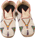 American Indian Art:Beadwork and Quillwork, A PAIR OF CHEYENNE BEADED HIDE MOCCASINS. c. 1930... (Total: 2Items)
