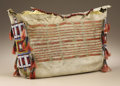 Native American:Textiles, Sioux Tipi Bag. Circa 1875. Length 13 1/2 in. Width 21 1/2 in..This native tanned buffalo hide bag is decorated across th...