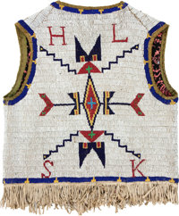 A SIOUX PICTORIAL BEADED AND FRINGED HIDE VEST c. 1900
