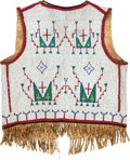 American Indian Art:Beadwork and Quillwork, A SIOUX BEADED AND FRINGED HIDE VEST. c. 1890...