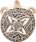 American Indian Art:Pottery, AN ACOMA BLACK -ON-WHITE CANTEEN. Marie Z. Chino. c. 1965...