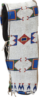 A SIOUX BEADED HIDE BABY CARRIER c. 1890