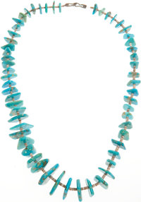 A NAVAJO TURQUOISE AND SHELL NECKLACE
