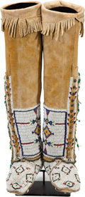 American Indian Art:Beadwork and Quillwork, A PAIR OF CHEYENNE BEADED HIDE BOOT MOCCASINS. c. 1900... (Total: 2Items)