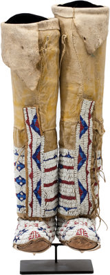 A PAIR OF CHEYENNE BEADED HIDE BOOT MOCCASINS c. 1890