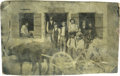 "Photography:Tintypes, Tintype of Store Front, African-Americans and Ox Cart. 4"" x 2.5"",features a group of men and children, including two Africa..."