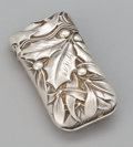 Silver Smalls:Match Safes, AN AMERICAN SILVER MATCH SAFE WITH HOLLY LEAF AND BERRY. WhitingManufacturing Company, New York, New York, circa 1900. Mark...