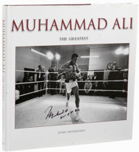 Muhammad Ali Multi-Signed Book. Impressive hardcover copy of Muhammad Ali The Greatest by John Hennessy is a photograph...