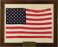 "Autographs:Celebrities, Large U.S. Flag Flown in Space Aboard Gemini 7, 18"" x 12"". Placedon mat and framed to 22.5"" x 18.5"". A metal plaque has bee...(Total: 1 Item)"
