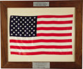 "Autographs:Celebrities, Large U.S. Flag Flown in Space Aboard Gemini 9, 18"" x 12"". Placedon mat and framed to 23.5"" x 19.5"". Two metal plaques have...(Total: 1 Item)"