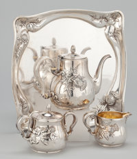 AN AMERICAN THREE-PIECE SILVER AND SILVER GILT TEA SERVICE WITH TRAY, THISTLE DESIGN Whiting Manufacturing Compan