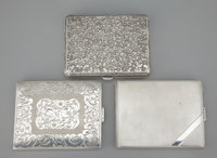 A GROUP OF THREE AMERICAN SILVER CIGARETTE CASES Maker unidentified, American, circa 1930 Marks: STERLING