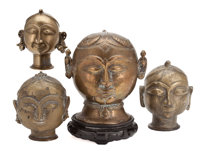 The Collection of Paul Gregory and Janet Gaynor  A GROUP OF 4 SMALL BRASS BUDDHA HEADS India, 19