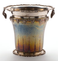 THE COLLECTION OF PAUL GREGORY AND JANET GAYNOR  A SPANISH SILVER WINE COOLER WITH HAND HAMMERED FINISH