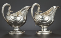 A PAIR OF GEORGE III SILVER SAUCEBOATS Williams Holmes, London, England, circa 1775-1776 Marks: (lion passant)