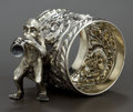 Silver Holloware, American:Napkin Rings, AN AMERICAN SILVER PLATED FIGURAL NAPKIN RING . Maker unknown,American, circa 1875. Marks: 064. 2 inches high (5.1 cm)...
