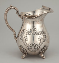 AN AMERICAN SILVER REPOUSSÉ WATER PITCHER Poole Silver Co., Taunton, Massachusetts, circa 1930 Marks: Old E