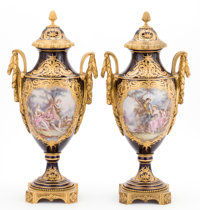 A PAIR OF FRENCH SÈVRES-STYLE PORCELAIN COVERED URNS WITH GILT BRONZE MOUNTS Probably Paris, France, circa 1900