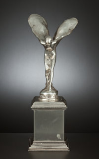 AN ENGLISH SILVER AUTOMOBILE MASCOT SPIRIT OF ECSTASY Designed by Charles Robinson Sykes (En