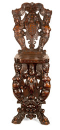 Furniture : Continental, A NEAR PAIR OF CONTINENTAL RENAISSANCE-STYLE CARVED WALNUT HALL CHAIRS . Probably Germany, 17th century and later. Unmarked... (Total: 2 Items)