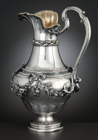 A FRENCH SILVER PLATED AND GILT WATER PITCHER Christofle, Paris, France, circa 1920 Marks: CHRISTOFLE</