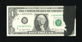 Error Notes:Ink Smears, Fr. 1910-G $1 1977A Federal Reserve Note. Gem Crisp Uncirculated..The black ink smear on the face of this note is over an i...