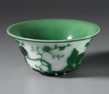 Other, CHINESE CARVED GLASS BOWL. Chinese carved Beijing glass overlay bowl, with green floral designs and birds on white ground...