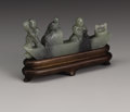 Asian:Chinese, CHINESE CARVED JADE/HARDSTONE GROUP. Chinese carved jade/hardstonegroup depicting a figure directing a boat while the oth...