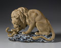 Asian:Chinese, CERAMIC FIGURE OF A LION. Ceramic figure of a lion attacking asnake. On a glazed base. Marked to base 'CHINA, 285'. 9in. ...