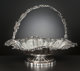 A GEORGE III SILVER SWING HANDLE BASKET John Scofield (Schofield), London, England, circa 1791-1792 Marks: (lion passant...